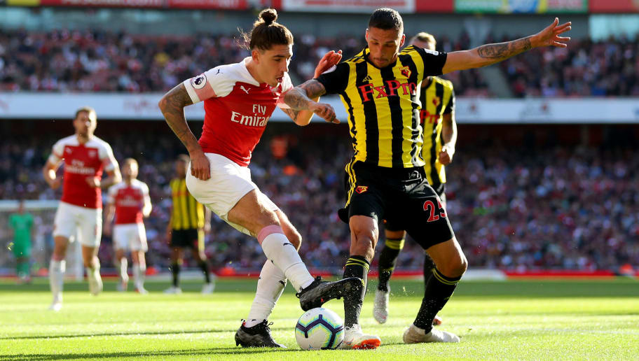 LONDON, ENGLAND - SEPTEMBER 29:  Hector Bellerin of Arsenal battles for possession with Jose Holebas (R) of Watford during the Premier League match between Arsenal FC and Watford FC at Emirates Stadium on September 29, 2018 in London, United Kingdom.  (Photo by Catherine Ivill/Getty Images)