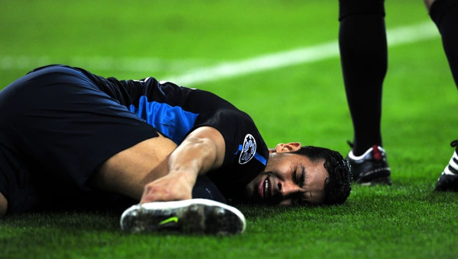 Arsenal's Andre Santos reacts after getting injured during their group F Champions league football match against Olympiacos, in Piraeus, near Athens on December 6 , 2011. AFP PHOTO / ARIS MESSINIS (Photo credit should read ARIS MESSINIS/AFP/Getty Images)