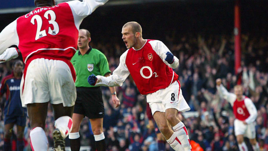 LONDON, UNITED KINGDOM:  Arsenal's Fredrik Ljunberg celebrates his goal, which brought the score to 2-1 for Arsenal in their match against Middlesbrough, at Highbury in London 24 January 2004. AFP PHOTO Nicolas ASFOURI   (Photo credit should read NICOLAS ASFOURI/AFP/Getty Images)