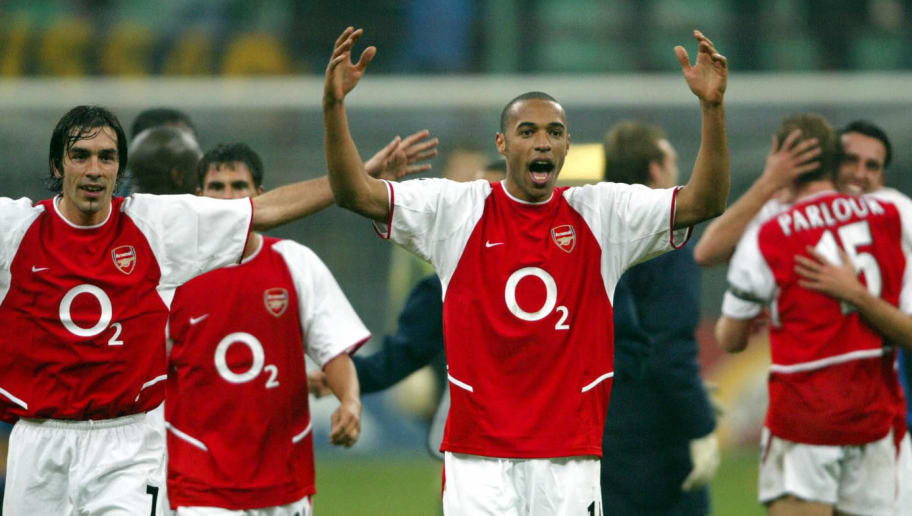 MILAN, ITALY:  Arsenal's French forward Thierry Henry (C) celebrates with teammates Robert Pires (L) and Ray Parlour (R) at the end of the Champions league group B match Inter Milan vs Arsenal at Milan's San Siro stadium 25 November 2003. Arsenal won the match 5-1.        AFP PHOTO PAOLO COCCO  (Photo credit should read PAOLO COCCO/AFP/Getty Images)