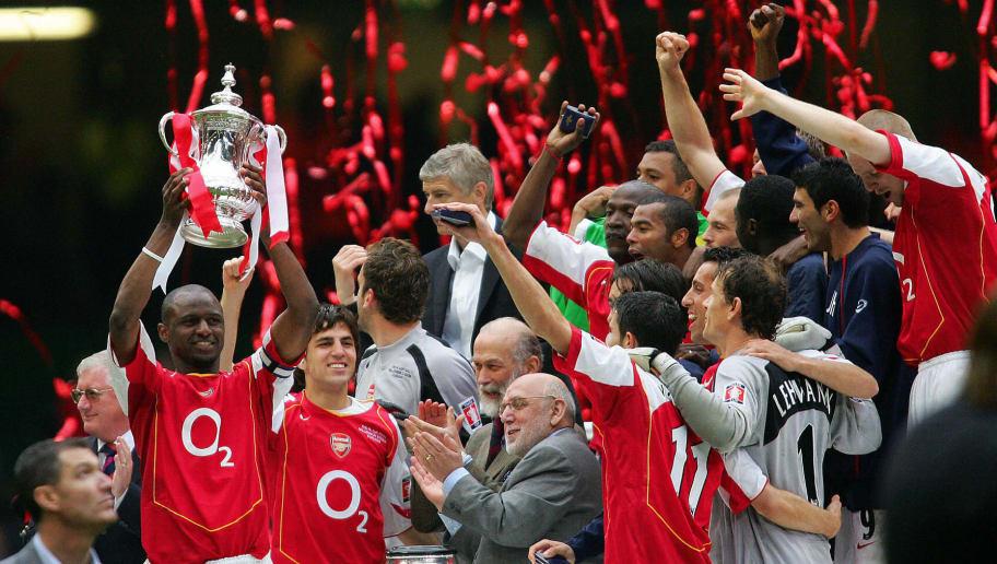 Arsenal's Patrick Vieira (L) lifts the F
