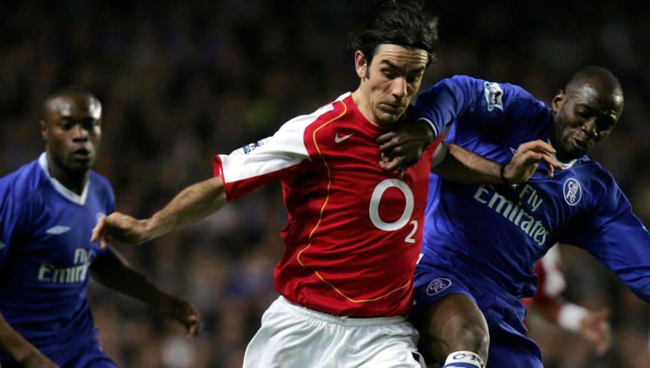 Arsenal 's Robert Pires battles Chelsea'