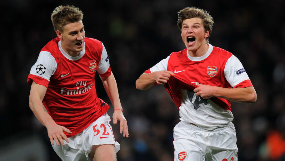 Arsenal's Russian midfielder Andrey Arshavin (R) celebrates after scoring a goal during the Champions League round of 16 first leg football match Arsenal vs FC Barcelona on February 16, 2011 at the Emirates stadium in London.  AFP PHOTO / LLUIS GENE (Photo credit should read LLUIS GENE/AFP/Getty Images)