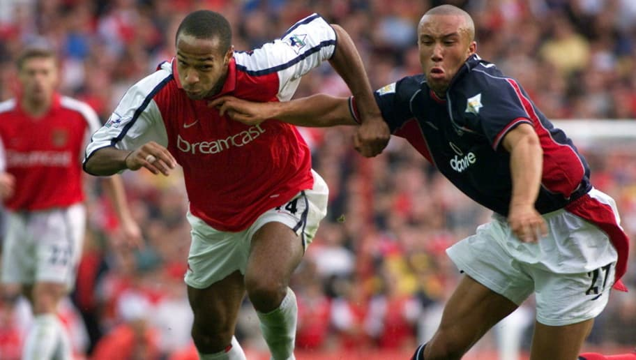LONDON, UNITED KINGDOM:  Arsenal's Thierry Henry (L) battles with Manchester United's Mikael Silvestre (R) during the premiership match at Highbury in London 01 October 2000. Thierry Henry scored a first-half goal to give Arsenal victory 1-0 which moves them joint top of the premiership league with Manchester United and Leicester. AFP PHOTO ADRIAN DENNIS (Photo credit should read ADRIAN DENNIS/AFP/Getty Images)
