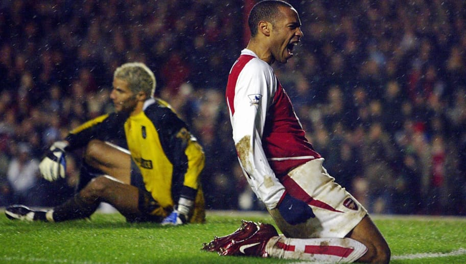 LONDON, UNITED KINGDOM:  Arsenal's Thierry Henry (R) celebrates his goal as keeper David James of Manchester City despairs during their FA Premier League clash at Highbury in London,01 February  2004.Arsenal defeated Manchester City 2-1. AFP PHOTO / ODD ANDERSEN       - - No telcos,website use to description of license with FAPL on, www.faplweb.com - -  (Photo credit should read ODD ANDERSEN/AFP/Getty Images)