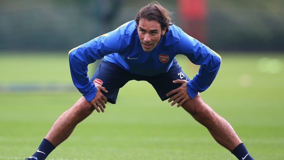 ST ALBANS, ENGLAND - SEPTEMBER 30:  Robert Pires warms up during an Arsenal training session ahead of their Champions League Group F match against Napoli at London Colney on September 30, 2013 in St Albans, England.  (Photo by Paul Gilham/Getty Images)