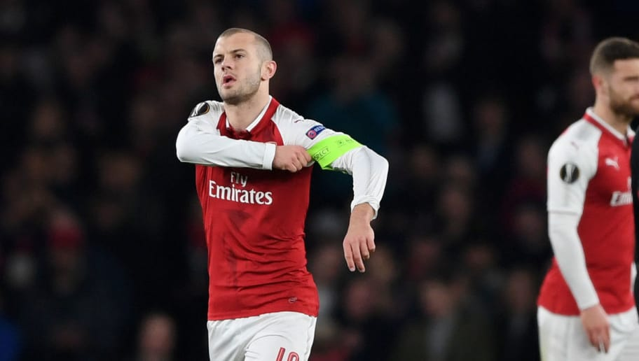 LONDON, ENGLAND - MARCH 15:  Jack Wilshere of Arsenal puts on the Captains armband after the injury of Laurent Koscielny during the UEFA Europa League Round of 16 Second Leg match between Arsenal and AC Milan at Emirates Stadium on March 15, 2018 in London, England.  (Photo by Shaun Botterill/Getty Images)