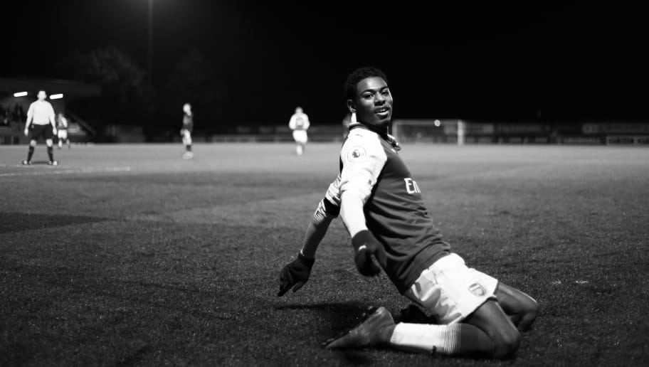 BOREHAMWOOD, ENGLAND - JANUARY 23:  (EDITORS NOTE - This image has been converted to black and white) Jeff Reine-Adelaide of Arsenal celebrates after scoring his sides fourth goal during the Premier League International Cup match between Arsenal and Bayern Munich at Meadow Park on January 23, 2018 in Borehamwood, England.  (Photo by Naomi Baker/Getty Images)