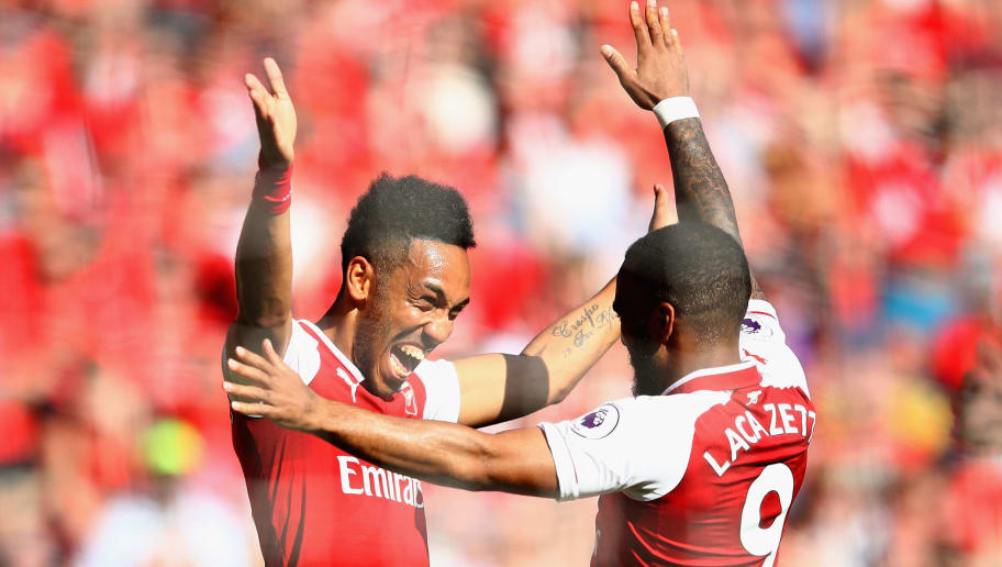 LONDON, ENGLAND - MAY 06:  Pierre-Emerick Aubameyang of Arsenal celebrates after scoring his sides first goal with Alexandre Lacazette of Arsenal during the Premier League match between Arsenal and Burnley at Emirates Stadium on May 6, 2018 in London, England.  (Photo by Clive Mason/Getty Images)