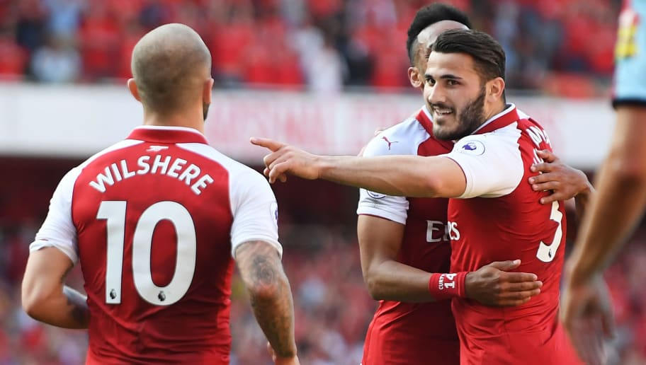 LONDON, ENGLAND - MAY 06:  Sead Kolasinac of Arsenal celebrates with Pierre-Emerick Aubameyang of Arsenal after he scores his sides second goal as Jack Wilshere of Arsenal looks on during the Premier League match between Arsenal and Burnley at Emirates Stadium on May 6, 2018 in London, England.  (Photo by Mike Hewitt/Getty Images)
