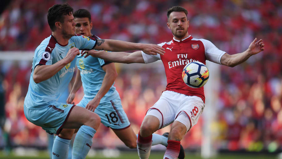 LONDON, ENGLAND - MAY 06:  Aaron Ramsey of Arsenal is challenged by Kevin Long of Burnley during the Premier League match between Arsenal and Burnley at Emirates Stadium on May 6, 2018 in London, England.  (Photo by Mike Hewitt/Getty Images)