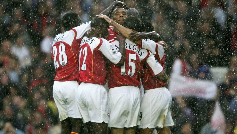 LONDON - OCTOBER 2:  Thierry Henry (C) of Arsenal is congratulated by his team mates after he scores their third goal during the Barclays Premiership match between Arsenal and Charlton Atheltic at Highbury on October 2, 2004 in London. (Photo by Shaun Botterill/Getty Images)