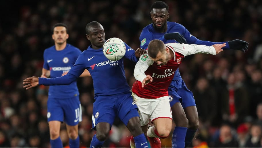 LONDON, ENGLAND - JANUARY 24: Ngolo Kante of Chelsea an Jack Wilshere of Arsenal and Tiemoue Bakayoko of Chelsea during the Carabao Cup Semi-Final Second Leg match between Arsenal and Chelsea at The Emirates Stadium on January 24, 2018 in London, England. (Photo by Matthew Ashton - AMA/Getty Images)