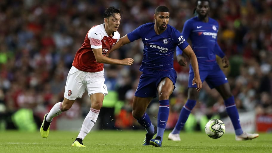 DUBLIN, DUBLIN - AUGUST 01:  Mesut Ozil of Arsenal(L) looks to break past Ruben Loftus-Cheek of Chelsea during the International Champions Cup 2018 match between Arsenal and Chelsea at the Aviva Stadium on August 1, 2018 in Dublin, Ireland.  (Photo by Alex Morton/International Champions Cup/Getty Images)