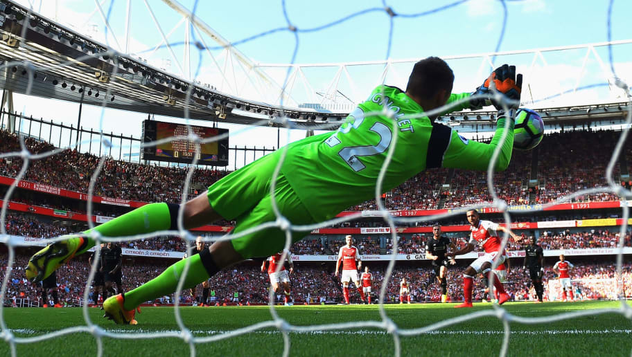 LONDON, ENGLAND - AUGUST 14:  Theo Walcott of Arsenal sees his penalty saved by Simon Mignolet of Liverpool during the Premier League match between Arsenal and Liverpool at Emirates Stadium on August 14, 2016 in London, England.  (Photo by Michael Regan/Getty Images)