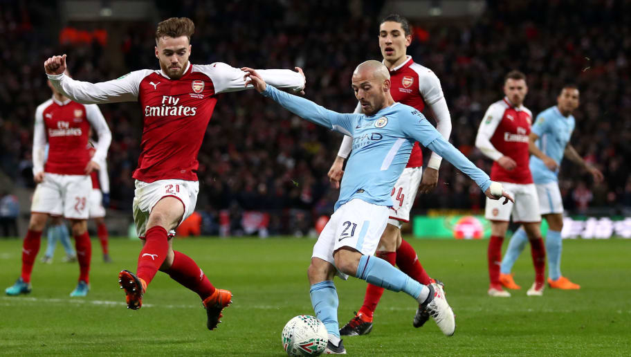 LONDON, ENGLAND - FEBRUARY 25:  David Silva of Manchester City scores the third Manchester City goal during the Carabao Cup Final between Arsenal and Manchester City at Wembley Stadium on February 25, 2018 in London, England.  (Photo by Catherine Ivill/Getty Images)