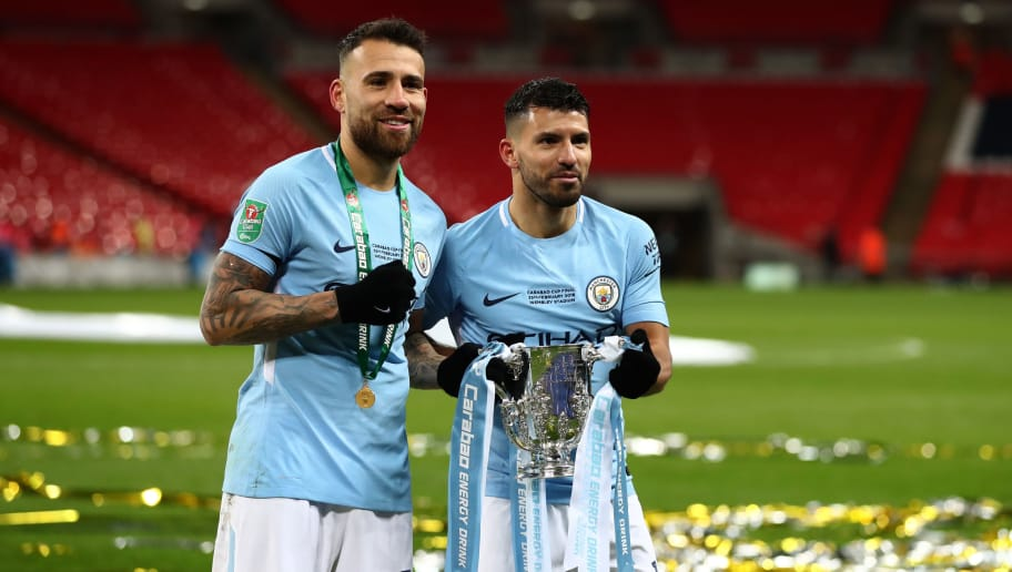LONDON, ENGLAND - FEBRUARY 25: Nicolas Otamendi and Sergio Aguero of Manchester City celebrate with the trophy after the Carabao Cup Final between Arsenal and Manchester City at Wembley Stadium on February 25, 2018 in London, England. (Photo by Catherine Ivill/Getty Images)