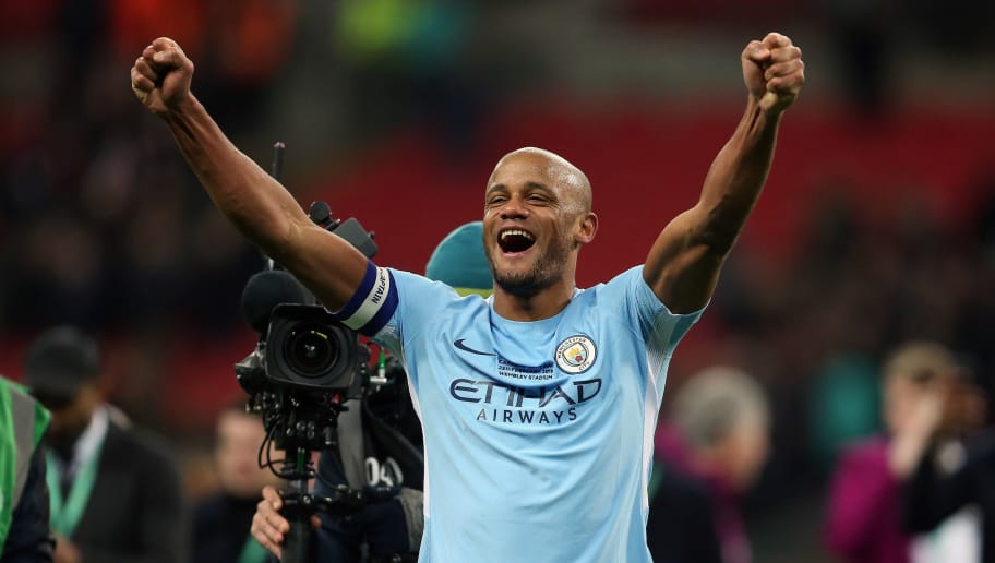 LONDON, ENGLAND - FEBRUARY 25: Vincent Kompany of Manchester City celebrates winning the match at full time after the Carabao Cup Final match between Arsenal and Manchester City at Wembley Stadium on February 25, 2018 in London, England. (Photo by James Baylis - AMA/Getty Images)