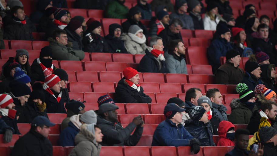 LONDON, ENGLAND - MARCH 01: Fans watch the match with empty seats all around during the Premier League match between Arsenal and Manchester City at Emirates Stadium on March 1, 2018 in London, England.  (Photo by Shaun Botterill/Getty Images)
