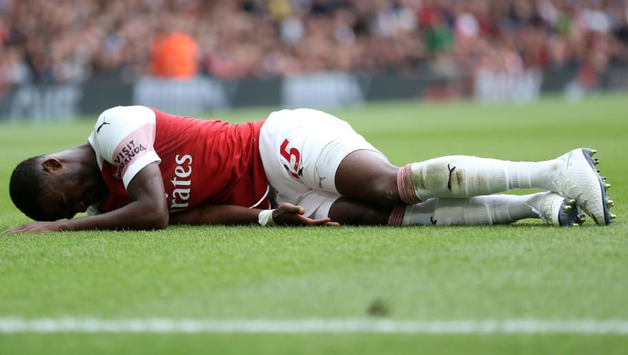 LONDON, ENGLAND - AUGUST 12: An injured Ainsley Maitland-Niles of Arsenal during the Premier League match between Arsenal FC and Manchester City at Emirates Stadium on August 12, 2018 in London, United Kingdom. (Photo by James Baylis - AMA/Getty Images)