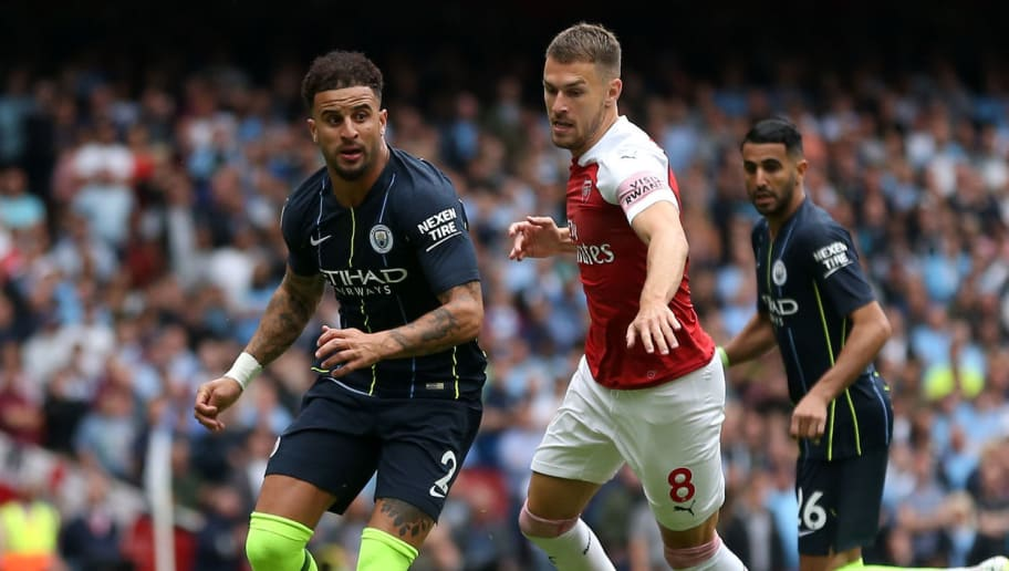 LONDON, ENGLAND - AUGUST 12: Kyle Walker of Manchester City and Aaron Ramsey of Arsenal during the Premier League match between Arsenal FC and Manchester City at Emirates Stadium on August 12, 2018 in London, United Kingdom. (Photo by James Baylis - AMA/Getty Images)