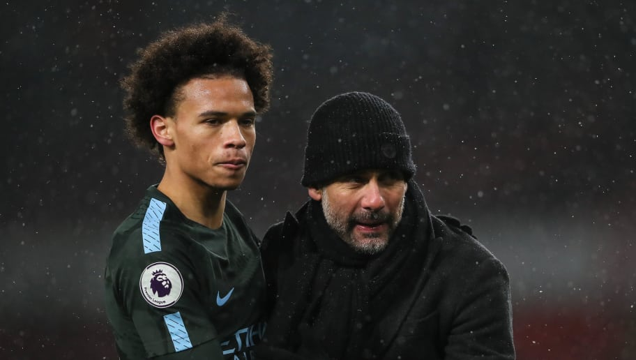LONDON, ENGLAND - MARCH 01: Leroy Sane of Manchester City and Pep Guardiola the head coach / manager of Manchester City at full time during the Premier League match between Arsenal and Manchester City at Emirates Stadium on March 1, 2018 in London, England. (Photo by Matthew Ashton - AMA/Getty Images)