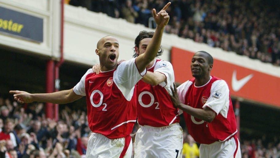 LONDON - MARCH 28:  Thierry Henry of Arsenal celebrates with Robert Pires and  Lauren after scoring the first goal for Arsenal during the FA Barclaycard Premiership match between Arsenal and Manchester United at Highbury on March 28, 2004 in London.  (Photo by Clive Mason/Getty Images)