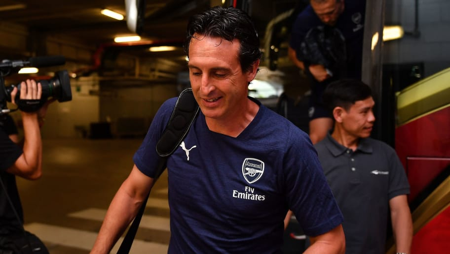 SINGAPORE - JULY 28: Unai Emery head coach of Arsenal smiles during the International Champions Cup match between Arsenal and Paris Saint Germain at the National Stadium on July 28, 2018 in Singapore.  (Photo by Thananuwat Srirasant/Getty Images  for ICC)