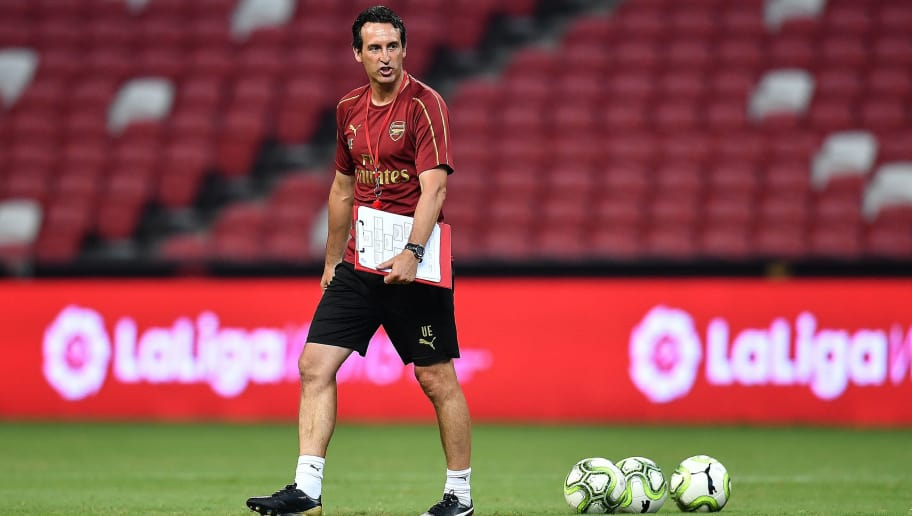 SINGAPORE - JULY 27: Unai Emery head coach of Arsenal looks during training ahead of the International Champions Cup 2018 match between Arsenal v Paris Saint Germain on July 27, 2018 in Singapore.  (Photo by Thananuwat Srirasant/Getty Images for ICC)