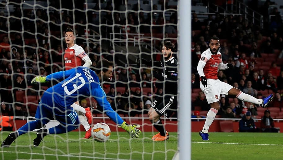 LONDON, ENGLAND - DECEMBER 13:  Alexandre Lacazette of Arsenal scores the opening goal of the game during the UEFA Europa League Group E match between Arsenal and Qarabag FK at Emirates Stadium on December 13, 2018 in London, United Kingdom.  (Photo by Marc Atkins/Getty Images)