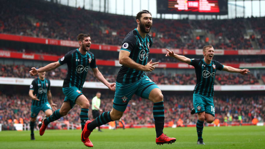 LONDON, ENGLAND - APRIL 08:  Charlie Austin of Southampton celebrates scoring their second goal during the Premier League match between Arsenal and Southampton at Emirates Stadium on April 8, 2018 in London, England.  (Photo by Julian Finney/Getty Images)