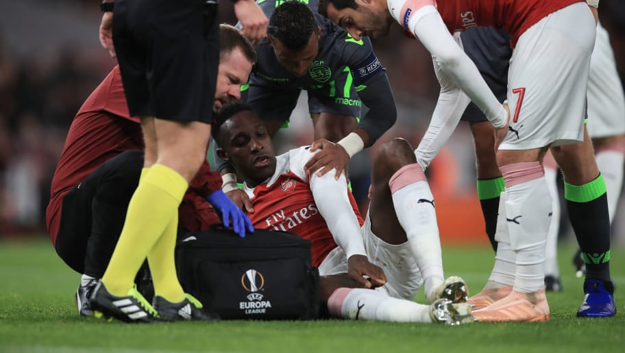 LONDON, ENGLAND - NOVEMBER 08: Danny Welbeck of Arsenal reacts to an injury during the UEFA Europa League Group E match between Arsenal and Sporting CP at Emirates Stadium on November 8, 2018 in London, United Kingdom. (Photo by Marc Atkins/Getty Images)
