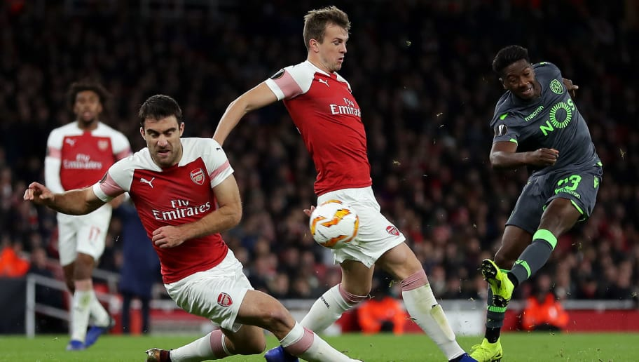 LONDON, ENGLAND - NOVEMBER 08:  Abdoulay Diaby of Sporting CP is blocked by Sokratis Papastathopoulos and Rob Holding of Arsenal during the UEFA Europa League Group E match between Arsenal and Sporting CP at Emirates Stadium on November 8, 2018 in London, United Kingdom.  (Photo by Richard Heathcote/Getty Images)