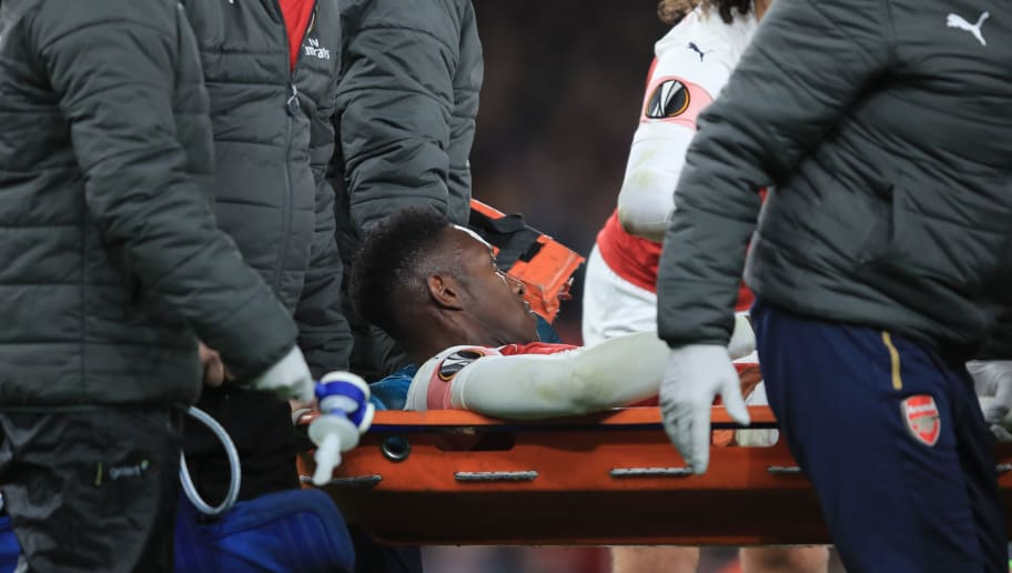 LONDON, ENGLAND - NOVEMBER 08: Danny Welbeck of Arsenal leaves the game on a stretcher during the UEFA Europa League Group E match between Arsenal and Sporting CP at Emirates Stadium on November 8, 2018 in London, United Kingdom. (Photo by Marc Atkins/Getty Images)