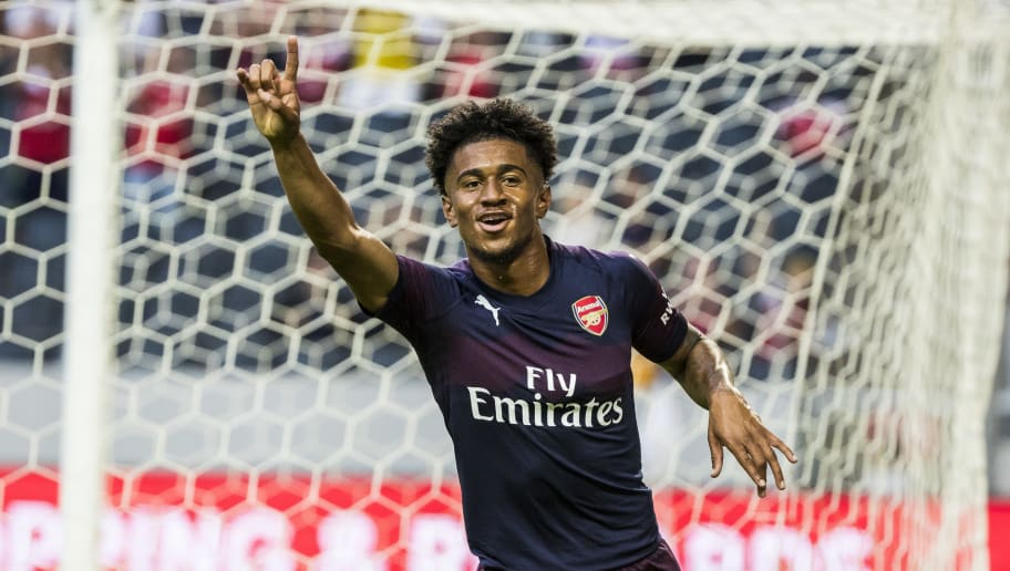 STOCKHOLM, SWEDEN - AUGUST 04: Reiss Nelson of Arsenal FC celebrates scoring the 1-0 goal during the Pre-season friendly between Arsenal and SS Lazio at Friends Arena on August 4, 2018 in Stockholm, Sweden. (Photo by MICHAEL CAMPANELLA/Getty Images)