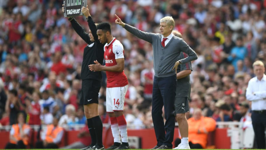 LONDON, ENGLAND - APRIL 22:  Arsene Wenger, Manager of Arsenal gestures as Pierre-Emerick Aubameyang of Arsenal comes on during the Premier League match between Arsenal and West Ham United at Emirates Stadium on April 22, 2018 in London, England.  (Photo by Shaun Botterill/Getty Images)
