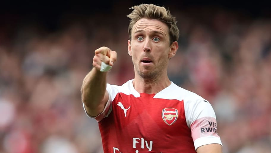 LONDON, ENGLAND - AUGUST 25: Nacho Monreal of Arsenal celebrates after scoring a goal to make it 1-1 during the Premier League match between Arsenal FC and West Ham United at Emirates Stadium on August 25, 2018 in London, United Kingdom. (Photo by James Williamson - AMA/Getty Images)
