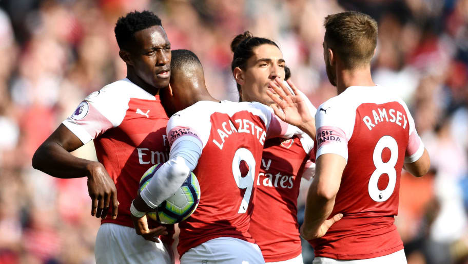 LONDON, ENGLAND - AUGUST 25:  Danny Welbeck of Arsenal celebrates with teammates after he scores his sides third goal during the Premier League match between Arsenal FC and West Ham United at Emirates Stadium on August 25, 2018 in London, United Kingdom.  (Photo by Clive Mason/Getty Images)