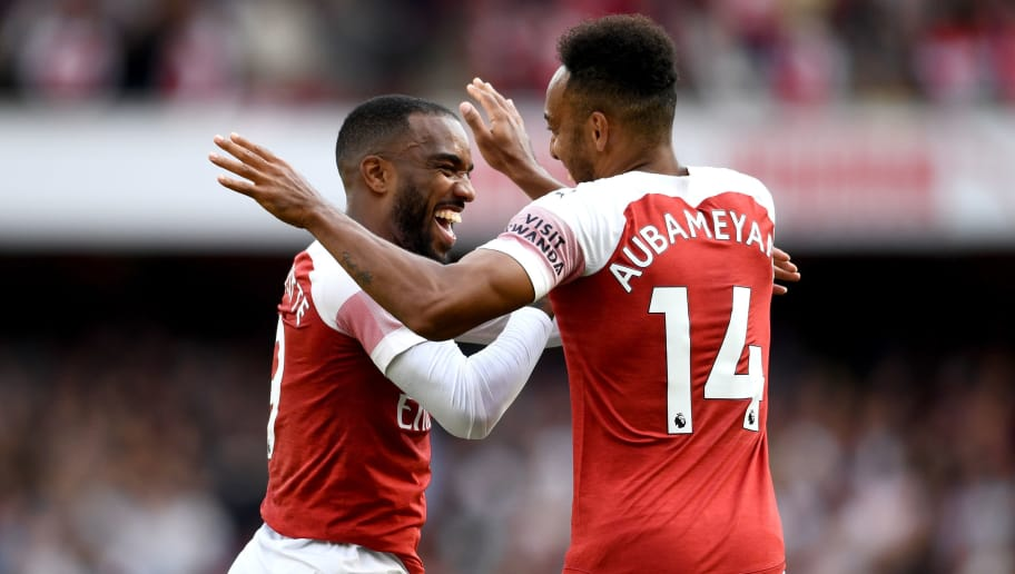LONDON, ENGLAND - AUGUST 25:  Alexandre Lacazette of Arsenal celebrates his team's second goal with Pierre-Emerick Aubameyang an own goal from Issa Diop of West Ham United (not pictured) during the Premier League match between Arsenal FC and West Ham United at Emirates Stadium on August 25, 2018 in London, United Kingdom.  (Photo by Clive Mason/Getty Images)