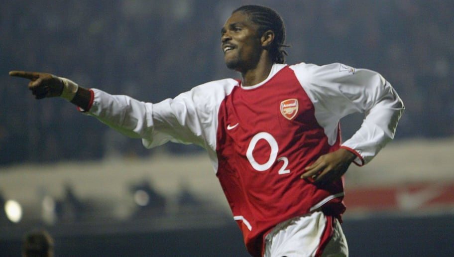 LONDON - DECEMBER 2:  Kanu of Arsenal celebrates scoring a goal during the Carling Cup fourth round match between Arsenal and Wolverhampton Wanderers at Highbury on December 2, 2003 in London.  (Photo by Clive Mason/Getty Images)