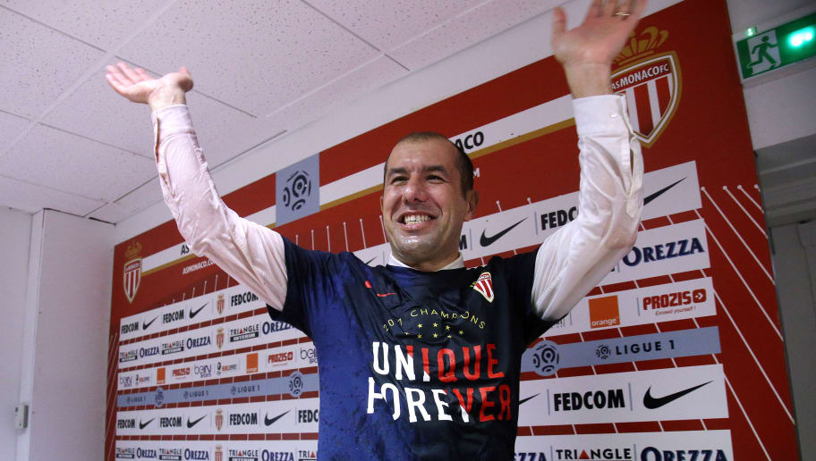 MONACO, MONACO - MAY 17: Coach of Monaco Leonardo Jardim is surprised and showered with champagne by his players during his press conference after winning the French League 1 championship title following AS Monaco and AS Saint-Etienne (ASSE) at Stade Louis II on May 17, 2017 in Monaco, Monaco. (Photo by Jean Catuffe/Getty Images)