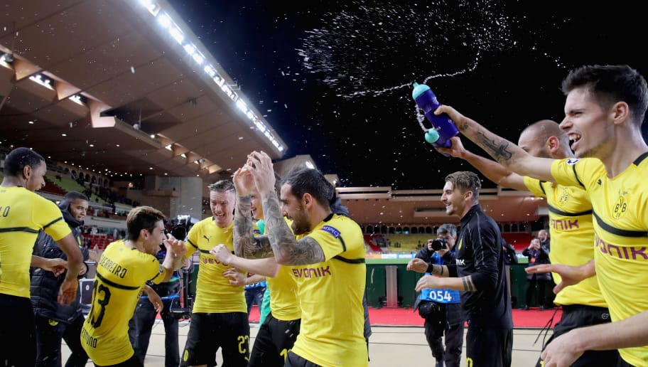 MONACO - DECEMBER 11:  Julian Weigl (R)  of Dortmund celebrates victory with his team mates after winning  the UEFA Champions League Group A match between AS Monaco and Borussia Dortmund at Stade Louis II on December 11, 2018 in Monaco, Monaco.  (Photo by Alexander Hassenstein/Bongarts/Getty Images)
