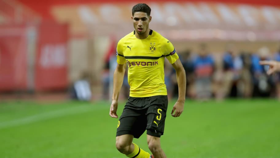 MONACO - DECEMBER 11:  Achraf Hakimi of Dortmund runs with the ball during the UEFA Champions League Group A match between AS Monaco and Borussia Dortmund at Stade Louis II on December 11, 2018 in Monaco, Monaco.  (Photo by Alexander Hassenstein/Bongarts/Getty Images)