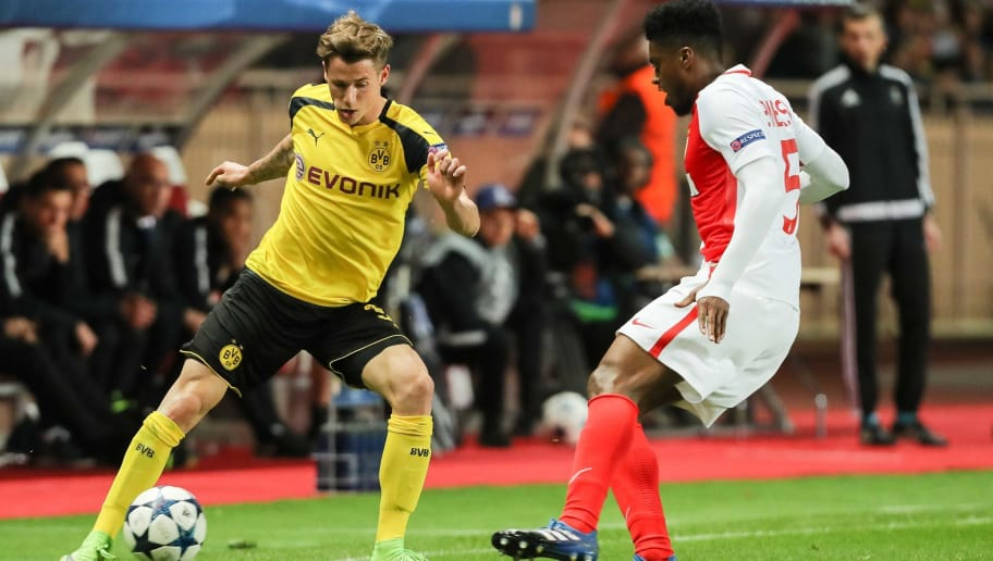 MONACO, MONACO - APRIL 19: Erik Durm of Dortmund and Jemerson of Monaco battle for the ball during the UEFA Champions League quarter final second leg match between AS Monaco and Borussia Dortmund of Dortmund at Stade Louis II on April 19, 2017 in Monaco, Monaco. (Photo by TF-Images/Getty Images)