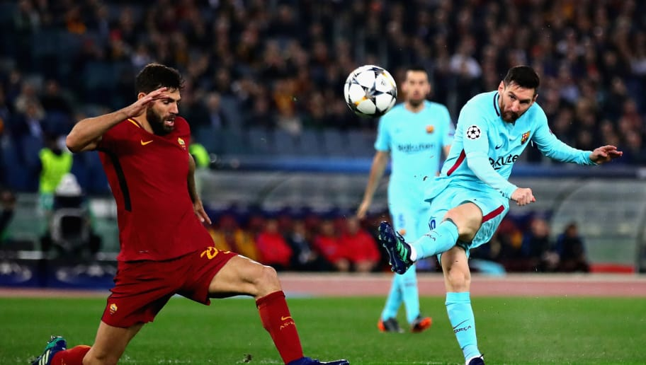 ROME, ITALY - APRIL 10:  Lionel Messi of FC Barcelona takes a shot as Federico Fazio of AS Roma attempts to block during the UEFA Champions Leagues Quarter Final, second leg match between AS Roma and FC Barcelona at Stadio Olimpico on April 10, 2018 in Rome, Italy.  (Photo by Chris Brunskill Ltd/Getty Images)