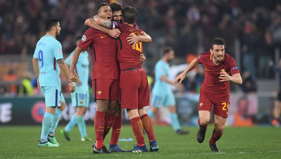 ROME, ITALY - APRIL 10:  Federico Fazio of AS Roma celebrates his sides victory with team mates Alessandro Florenzi Juan Jesus and Daniele De Rossi after the UEFA Champions League Quarter Final Second Leg match between AS Roma and FC Barcelona at Stadio Olimpico on April 10, 2018 in Rome, Italy.  (Photo by Michael Regan/Getty Images)