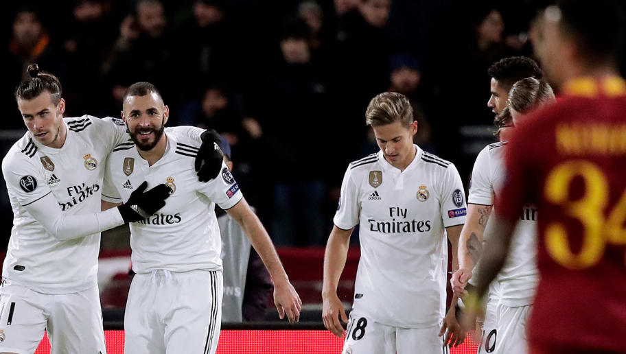 ROME, ITALY - NOVEMBER 27: Gareth Bale of Real Madrid celebrates 0-1 with Marcelo of Real Madrid, Karim Benzema of Real Madrid, Marcos Llorenta of Real Madrid  during the UEFA Champions League  match between AS Roma v Real Madrid at the Stadio Olimpico Rome on November 27, 2018 in Rome Italy (Photo by David S. Bustamante/Soccrates/Getty Images)