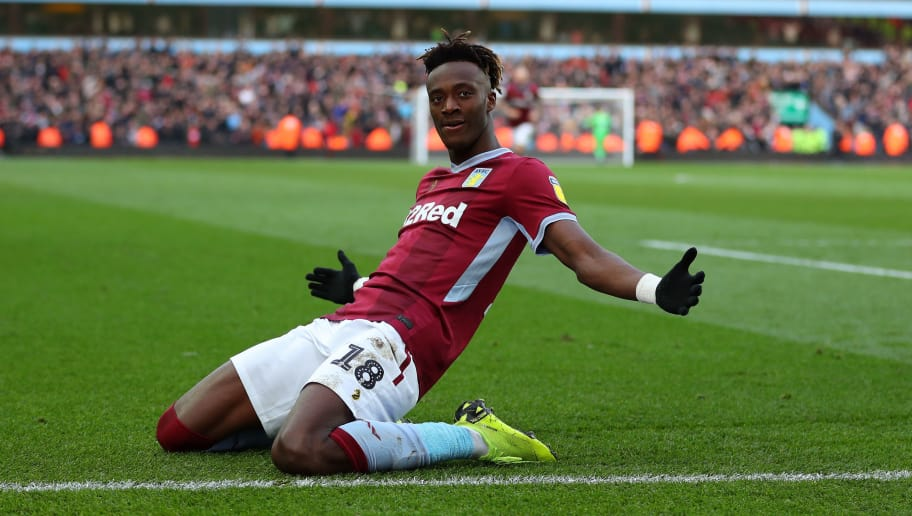 BIRMINGHAM, ENGLAND - NOVEMBER 25: Tammy Abraham of Aston Villa celebrates after he scores his teams third goal from the penalty spot during the Sky Bet Championship match between Aston Villa and Birmingham City at Villa Park on November 25, 2018 in Birmingham, England. (Photo by Catherine Ivill/Getty Images)
