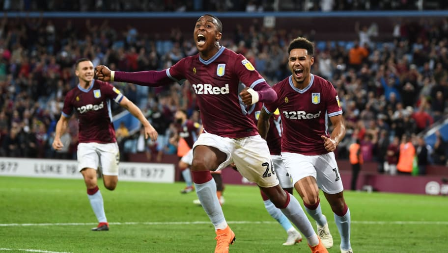 BIRMINGHAM, ENGLAND - AUGUST 22:  Jonathan Kodjia of Aston Villa celebrates after scoring his team's second goal during the Sky Bet Championship match between Aston Villa and Brentford at Villa Park on August 22, 2018 in Birmingham, England.  (Photo by Clive Mason/Getty Images)