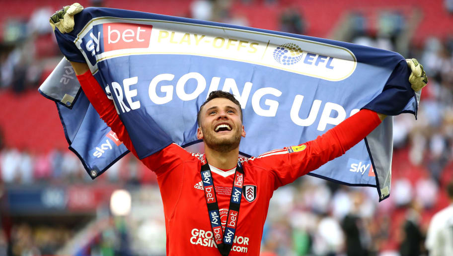 LONDON, ENGLAND - MAY 26:  Marcus Bettinelli of Fulham celebrates following his sides victory in the Sky Bet Championship Play Off Final between Aston Villa and  Fulham at Wembley Stadium on May 26, 2018 in London, England.  (Photo by Clive Mason/Getty Images)